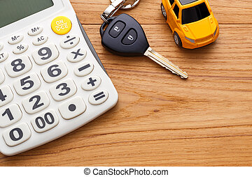 Car key with calculator on wood table
