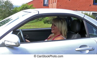 Car key - Young woman in her car