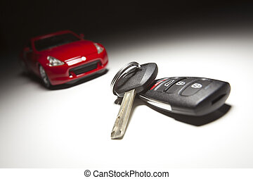 Car Keys and Sports Car Under Spot Light.