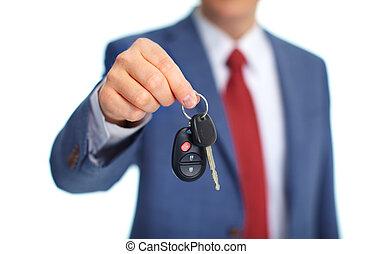 Car keys. - Hand with a Car keys. Isolated on white...