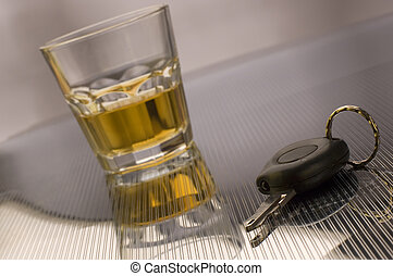 keys - car keys with glass of whiskey in background - drink...
