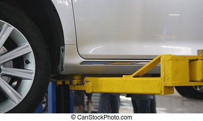 Car lifts - automobile service - small business, close up
