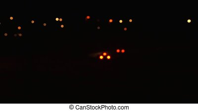 Car light moving on motorway in dark during the night, some...