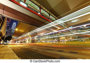 car light trails in modern city