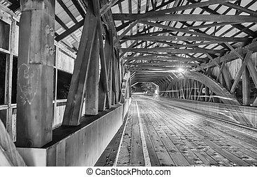 Car light trails inside a bridge at night