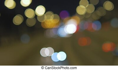 Car lights are blurred out of focus 4K