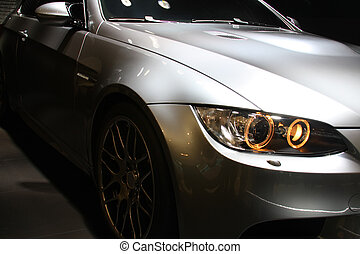 Car Lights - Front part of a coupe sports car. No logo...