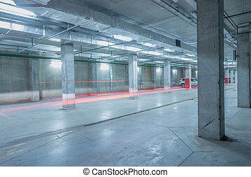 Car lights in the underground city parking.