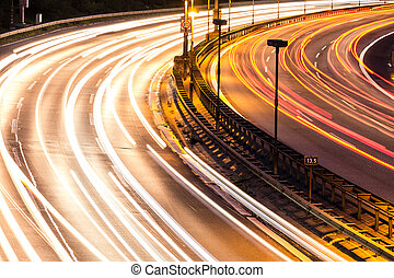 car lights on highway by night