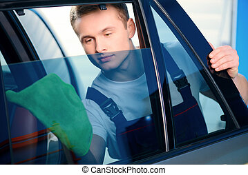 Car mechanic at the service station - Welcome to our car...