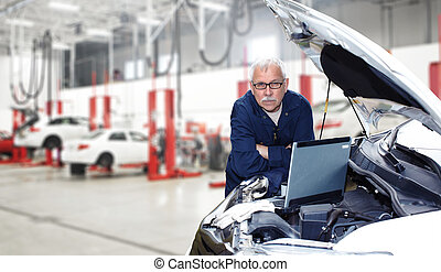 Car mechanic. - Car mechanic checking engine. Auto repair...