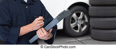 Car mechanic. - Car mechanic with wrench over vehicle ...