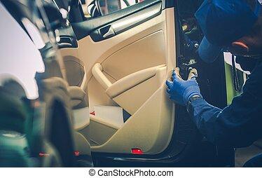 Car Mechanic Fixing Door Lock