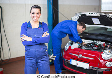 Car mechanic in garage or workshop
