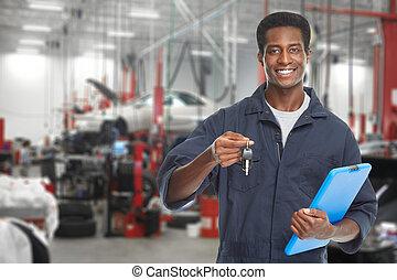 Car mechanic in garage.