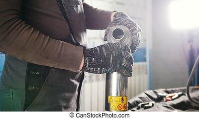 Car mechanic pours motor oil for car at repair service...