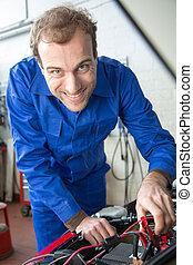 Car mechanic repairing a automobile