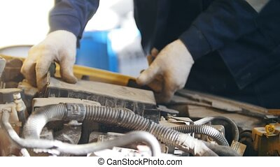 Car mechanic unscrewing device of automobile in service, close up