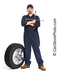 Car mechanic with a tire wrench.