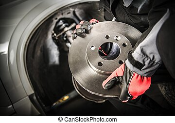 Car Mechanic with Brake Disc
