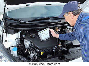 Car Mechanic with diagnostic equipment tablet