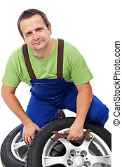 Car mechanic with tires
