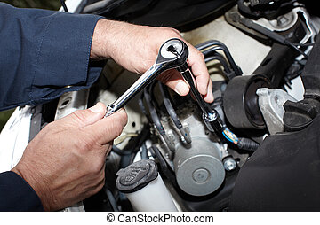 Car mechanic with wrench. - Hands of car mechanic with ...