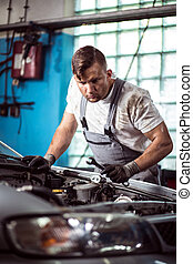 Car mechanic with wrench