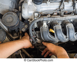 Car mechanic working in auto repair service