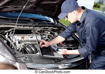 Car mechanic working in auto repair service. - Professional...