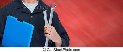 Car mechanic. - Young professional auto mechanic with wrench...