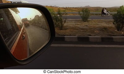 Car Mirror with Van in Reflection - Steady, exterior shot...