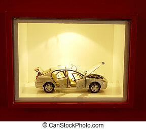 Car model in the shop window