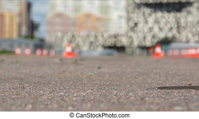 car move on track in sunny day - ground closeup