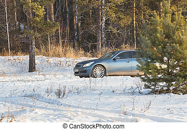 car moves in the winter on a snowy road