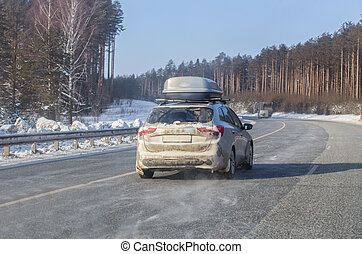 car moves in winter on a snow-covered country road