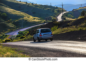 car moves on a mountain road