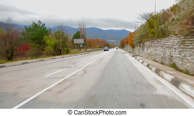 Car Moving Along Asphalt Road With Scenics View - This is a...
