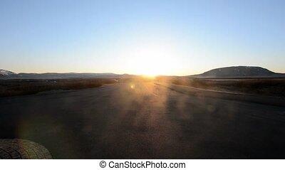 Car moving in Sunlight