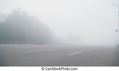 Car moving in the fog