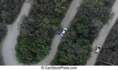 Car Moving on Curvy Mountain Road - Aerial view of a car...