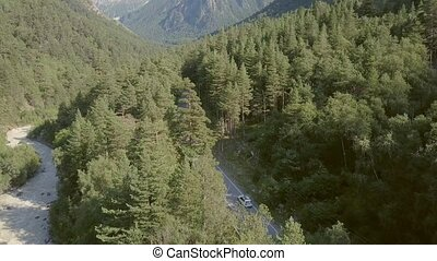 Car moving on highway among green forests. Aerial view car...