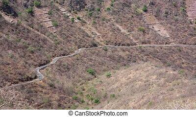 Car negotiating mountain road - Single car negotiating a...