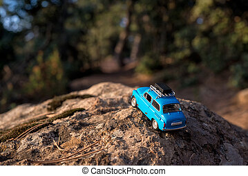 Car on a country road in mountains