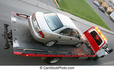 Car on a flatbed truck - Car towed on a flatbed truck