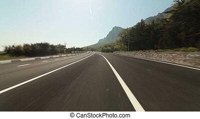 car on coastal mountain road