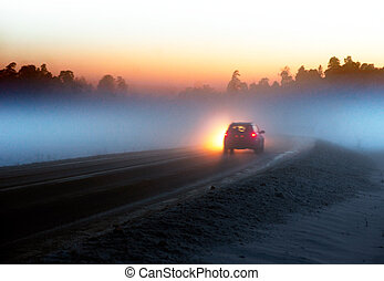 Car on country road at night in winter