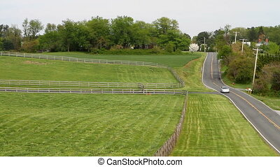 Car On Country Road - Car drives up a quite country road of...
