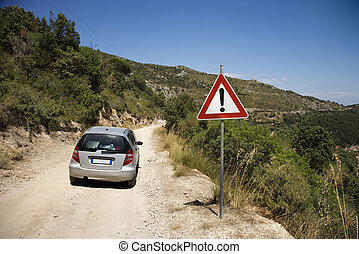 Car on dangerous road.