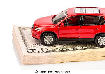 car on dollar bills - a car stands on dollar banknotes. ...